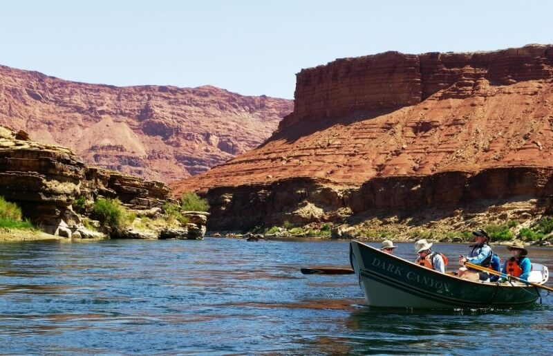 wooden boat on river in grand canyon on river rafting trip through grand canyon