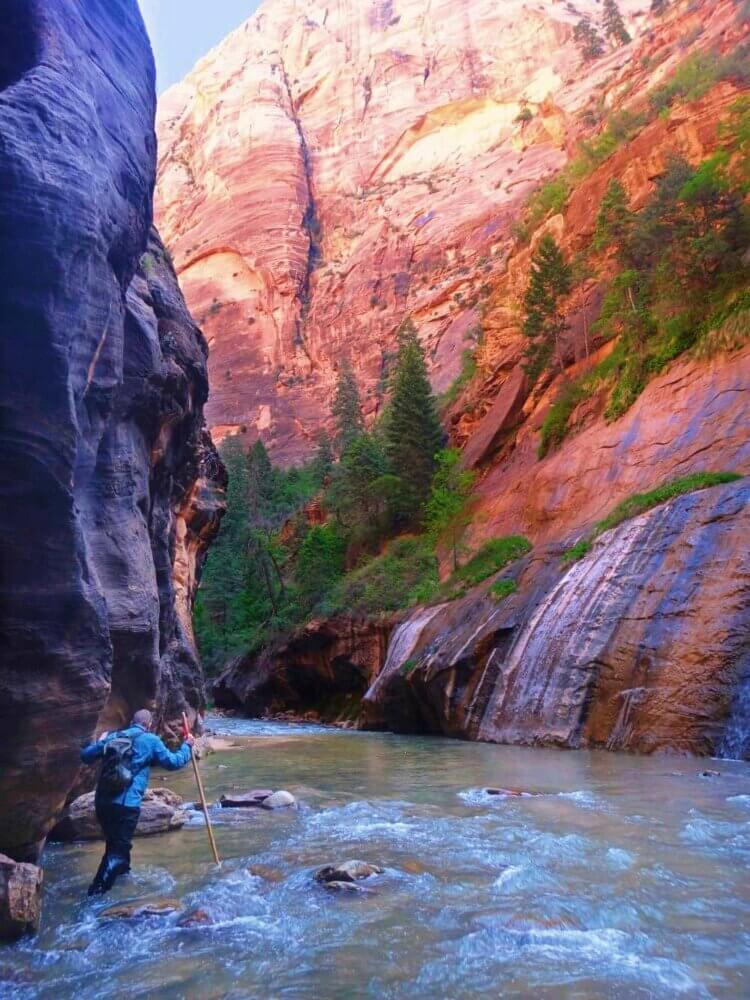James and waterfalls hiking the Narrows in Zion National Park