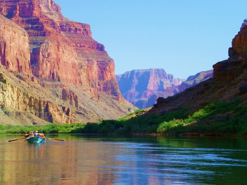 boat on river in grand canyon on river rafting trip through grand canyon