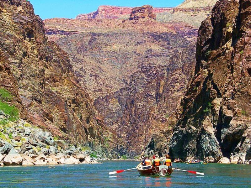 small wooden boats and oars inside grand canyon on river rafting trip through grand canyon