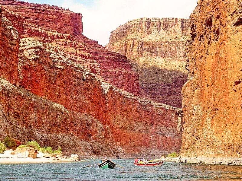 boats on river in grand canyon on river rafting trip through grand canyon