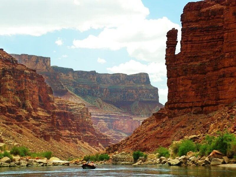 raft in grand canyon and pillar of stone on river rafting trip through grand canyon