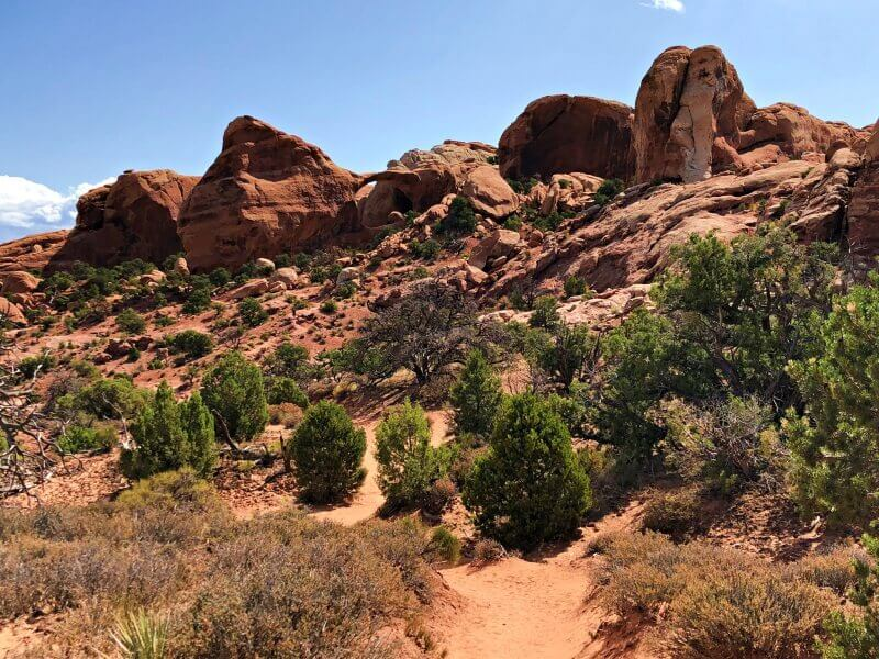 Heading-back-to-main-trail-with-double-o-arch-in-distance-Devils-Garden-TRail-Arches-National-Park
