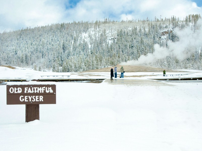 Yellowstone Winter Old Faithful sign and lots of snow
