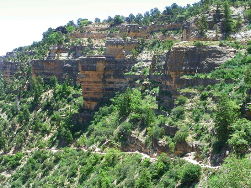 bright angel trail going along cliffside inside grand canyon